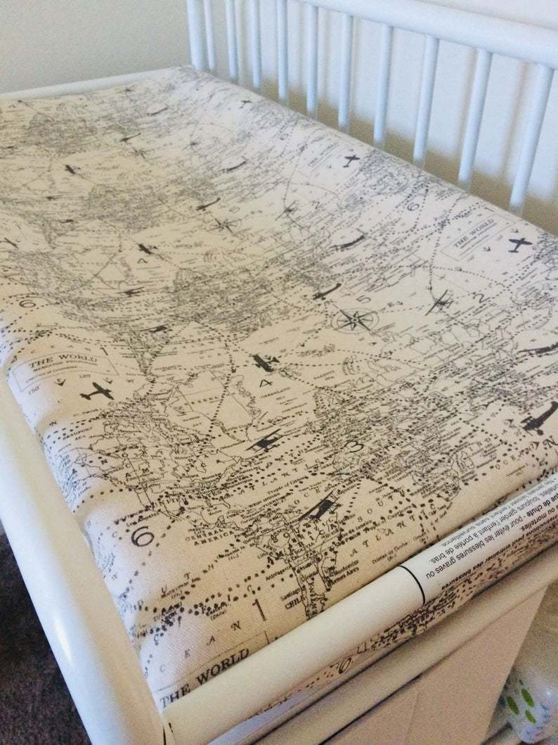 Baby changing mat with vintage style maps and planes