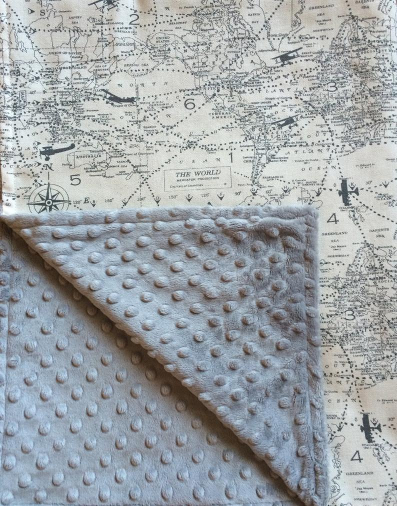 Baby blanket with vintage style maps and planes on one side and grey minky fleece on the other side